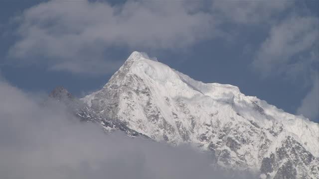 ms glacier covered mountain between dense clouds / mende, khumbu region, nepal - khumbu stock videos and b-roll footage