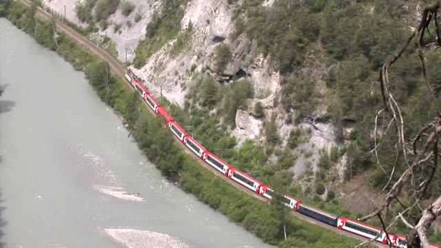 glacier express in the ruinalta (rheinschlucht) - passenger train stock videos & royalty-free footage