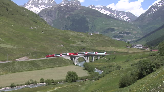 mgb glacier express in urserental crossing the richlerenbrücke - 2006 stock videos & royalty-free footage