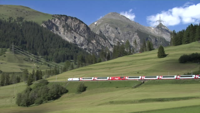 glacier express near bergün on the albula railway - passenger train stock videos & royalty-free footage