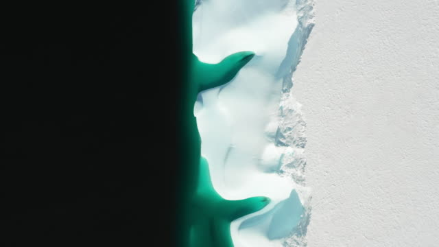 glacier floating in the antarctic sea - icecap stock videos & royalty-free footage