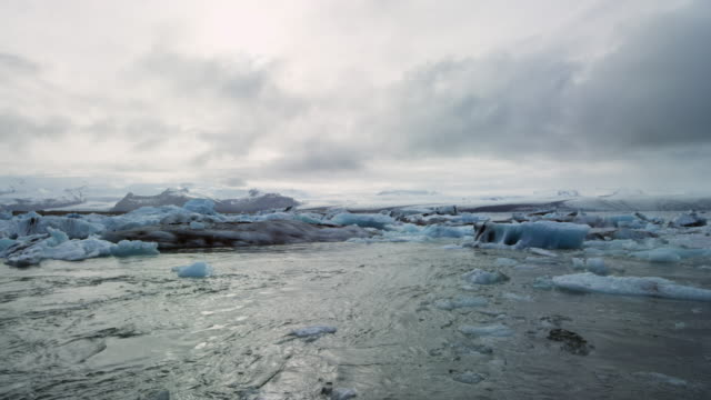 glacier lagoon in iceland with icebergs at sunset slow motion - arctic stock videos & royalty-free footage
