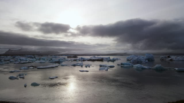 glacier lagoon in iceland with icebergs at sunset time lapse - north pole stock videos & royalty-free footage