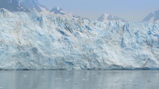 glacier melting in alaska - cliff stock videos & royalty-free footage