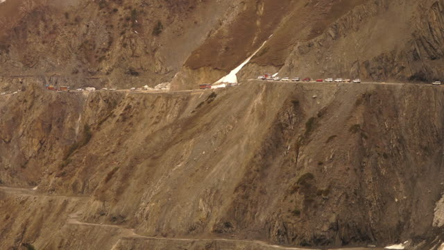glacier reduces traffic flow, ladakh mountain pass - other stock videos and b-roll footage