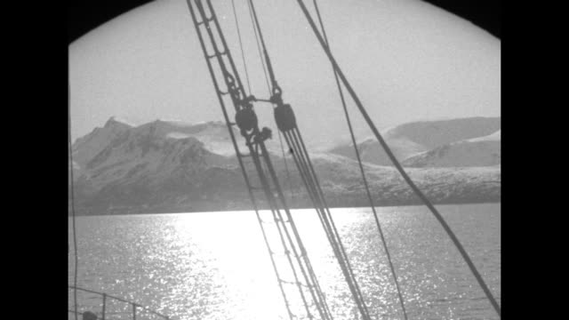 vs glaciers taken from ship / long shot glacier taken through ship's rigging / vs chunky ice fields / ice field breaking up as ship moves through it... - block shape stock videos & royalty-free footage