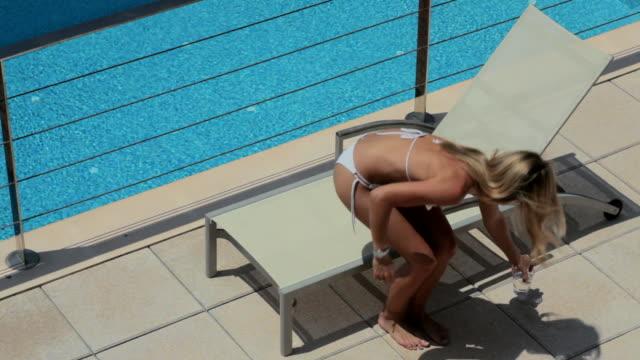 ha glamorous woman in bikini laying on sunlounger,mallorca - liegen stock-videos und b-roll-filmmaterial