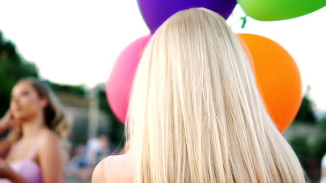 Glamorous woman with balloons