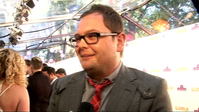 glamour awards alan carr talking to press sot carr interview sot on his outfit / on wearing tartan to support susan boyle / message to boyle gvs of... - tartan video stock e b–roll
