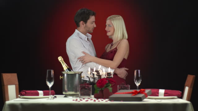 HD: Glamour Couple Kissing At Dinner Table