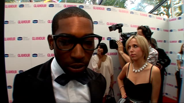 glamour women of the year awards 2010: red carpet arrivals; tinie tempah interview sot - on wanting to get in the studio with kelly rowland asap /... - ポピュラーミュージックツアー点の映像素材/bロール