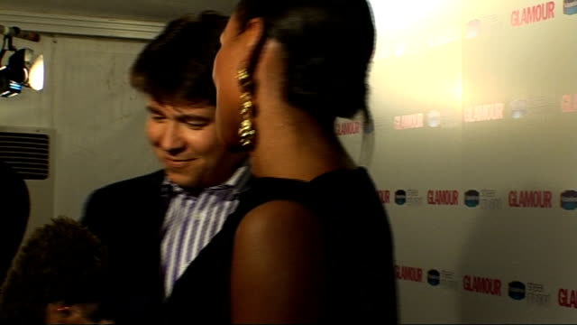 winners room ***flash england london berkeley square int alexandra burke and michael mcintyre posing for photographs / burke shows other crew the... - comedian stock videos and b-roll footage