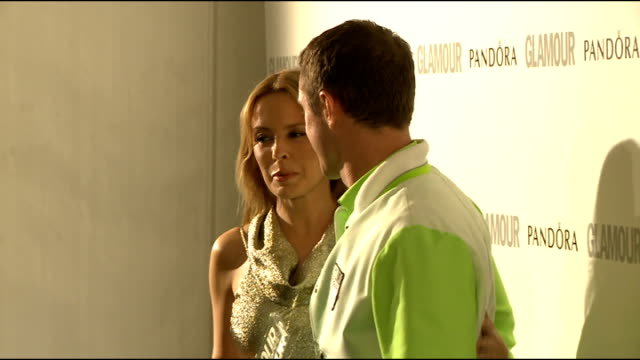 winners' room interviews Kylie Minogue posing for photographs with Jake Shears and holding her award
