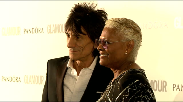 winners' room interviews Ronnie Wood and Dionne Warwick posing for photographs Kylie Minogue talking to press