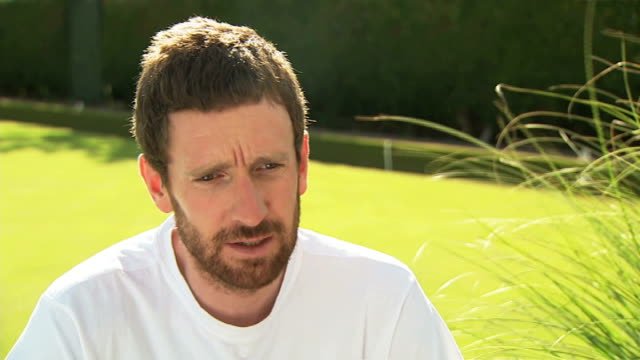 London athletes prepare Glasgow EXT Sir Bradley Wiggins interview SOT Wiggins leaning against tree