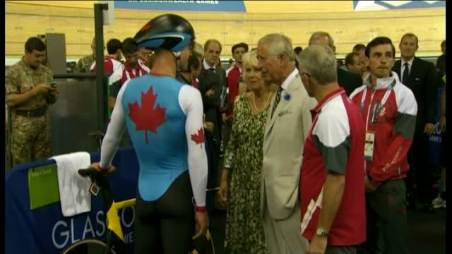 opening ceremony sir chris hoy velodrome int prince charles prince of wales and camilla duchess of cornwall talking to member of canadian cycling... - 開会式点の映像素材/bロール
