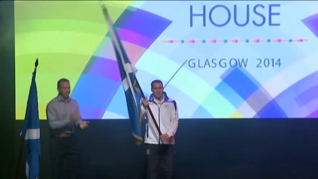 preparations / reactions of local people sir chris hoy handing scotland flag to euan burton on stage at scotland house event euan burton interview... - opening ceremony stock videos & royalty-free footage