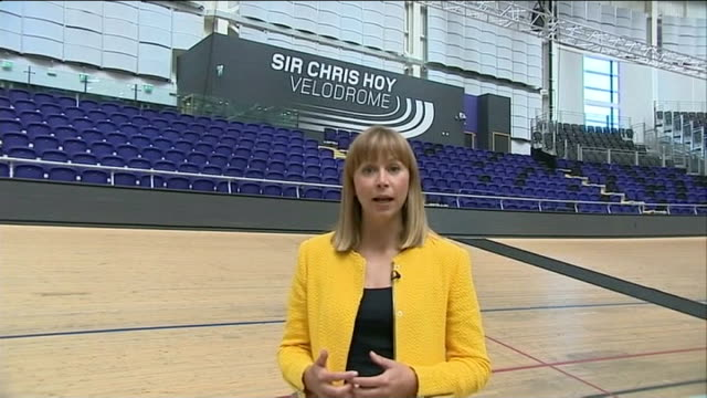 preparations / reactions of local people reporter to camera general view of commonwealth flags hanging from roof of sir chris hoy velodrome man on... - opening ceremony stock videos & royalty-free footage