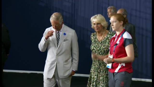 Prince Charles and Duchess of Cornwall tour Emirates Arena **Music heard SOT** Charles and Camilla entering hall and greeting people / Charles and...