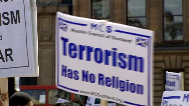glasgow airport attack: anti-terror rally organised by muslim groups; sign reading 'terrorism has no religion' being held up during anti-terror rally - the glasgow airport attack stock videos & royalty-free footage