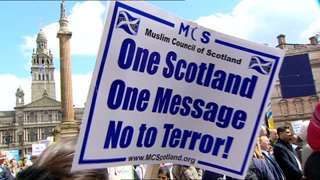 glasgow airport attack: anti-terror rally organised by muslim groups; glasgow: ext general views of people at anti-terror rally, including sign held... - the glasgow airport attack stock videos & royalty-free footage