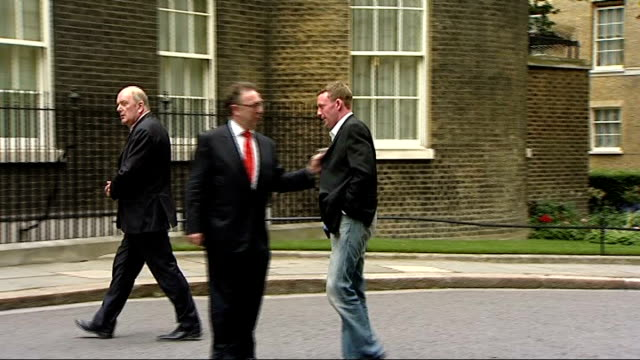 glasgow airport attack: baggage handler hailed a hero by gordon brown; england: london: downing street: ext john smeaton arriving at number 10 - the glasgow airport attack stock videos & royalty-free footage