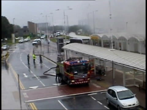 glasgow airport attack- pc stewart ferguson speaks out; tx 30.6.2007 glasgow airport: ext amateur video footage of firefighters hose down burning... - the glasgow airport attack stock videos & royalty-free footage