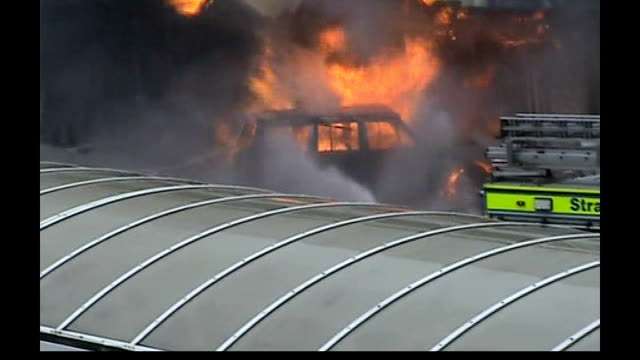 glasgow airport car bomb burning car smashed into front of airport building hosed down by unseen firefighters - glasgow international airport stock videos & royalty-free footage