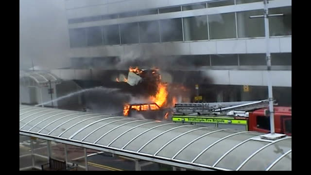 glasgow airport car bomb **jim manson phono interview over following pictures sot** flames and smoke pouring from vehicle crashed into galsgow... - phono einzelwort stock-videos und b-roll-filmmaterial