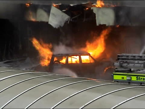 glasgow airport car bomb **john smeaton interview overlaid** firefighters hose down burning car that has smashed into front of glasgow airport - glasgow international airport stock videos & royalty-free footage