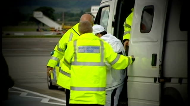 glasgow airport ext abdelbaset ali mohmed al megrahi from prison van on airport runway and shaking hands with prison staff and up steps to aircraft - glasgow international airport stock videos & royalty-free footage