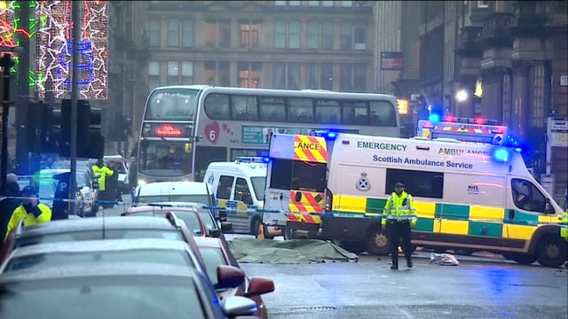 emergency workers at scene scotland glasgow george square ext bin lorry with emergency vehicle beside / cordoned off scene and ambulance bus turning... - trolley bus stock videos & royalty-free footage