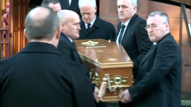 glasgow bin lorry crash: funeral held for three victims from same family; scotland: dumbarton: st patrick's rc church: ext mourners arriving at... - priest stock videos & royalty-free footage