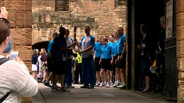 queen's baton relay linlithgow palace relay scotland linlithgow ext gvs batonbearer number 47 posing for photocall with queen's baton and local... - linlithgow stock videos and b-roll footage