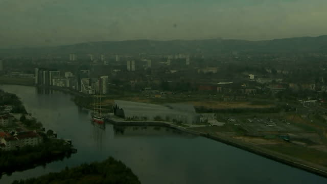Glasgow EXT Various high angle GVs of Glasgow buildings including the Clyde Auditorium the River Clyde Glasgow Cathedral Red Road flats tower blocks...