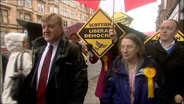 glasgow int ** beware charles kennedy mp at counter in bakery ext kennedy on walkabout during election campaign - charles kennedy stock videos & royalty-free footage