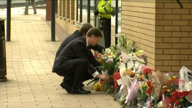 glasgow police helicopter crash / victims named nick clegg mp meeting emergency services at scene clegg leaving bouquet of flowers nick clegg mp... - ヘリコプター事故点の映像素材/bロール