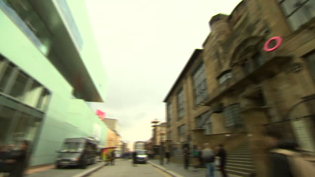 glasgow school of art buildings pan from newly opened building to existing building designed by rennie mackintosh - charles rennie mackintosh stock videos and b-roll footage