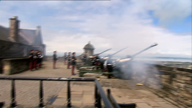 queen's baton relay at edinburgh castle more of cannons fired sot / national anthem played and soldiers standing to attention one holding queen's... - edinburgh castle stock videos & royalty-free footage