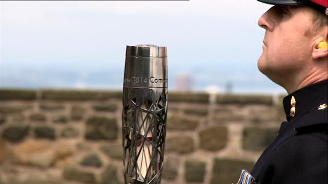 queen's baton relay at edinburgh castle scotland edinburgh ext military parade with queen's baton / bagpipe player along / gun salute cannons fired... - bagpipes stock videos & royalty-free footage