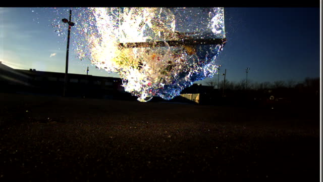 a glass aquarium smashes on the ground. - demolished stock videos & royalty-free footage