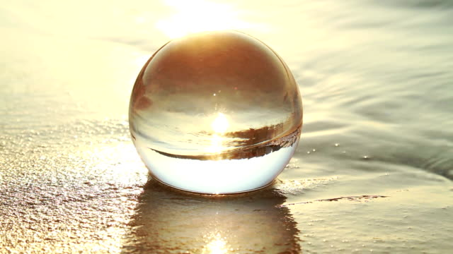 glass ball at beach - crystal ball stock videos & royalty-free footage