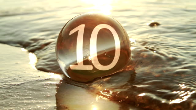 glass ball at seashore, countdown - number 10 stock videos & royalty-free footage