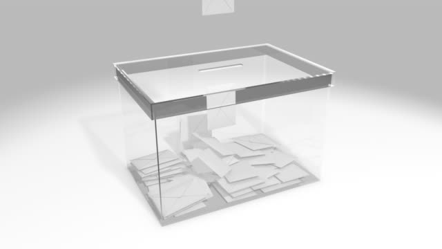 glass ballot box. envelopes with vote fall inside. - ballot box stock videos & royalty-free footage