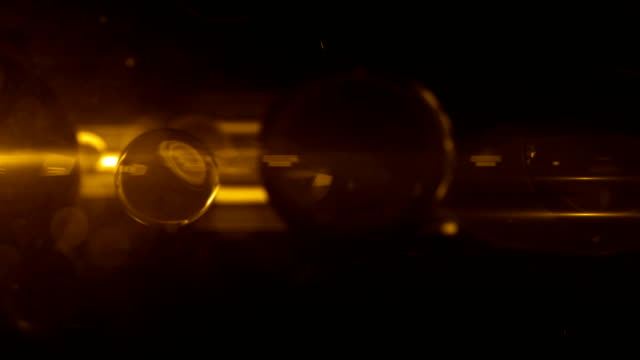 glass balls fluoro light reflection background loop - gold glow - fluorescent light stock videos & royalty-free footage