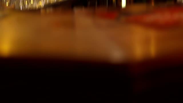 Glass Behind A Bar Counter
