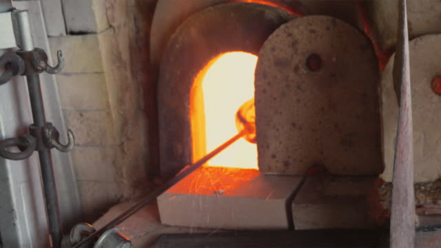 ms glass being heated in oven / venice, italy - industrie ofen stock-videos und b-roll-filmmaterial