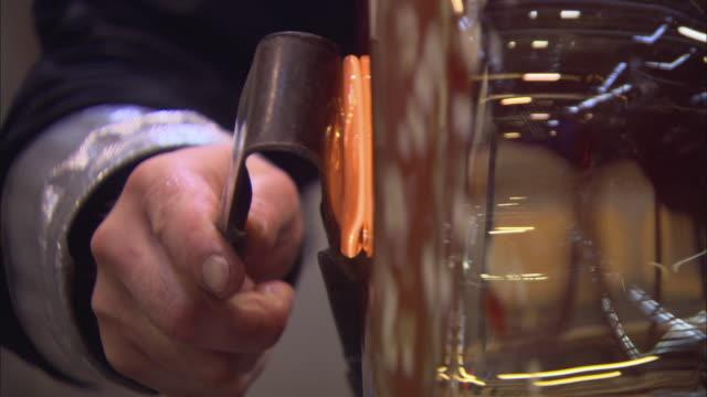 cu tu glass blower putting final touches on jar at glass factory / kosta, sweden - glasbläser stock-videos und b-roll-filmmaterial