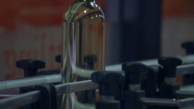 glass bottles factory - distillery still stock videos and b-roll footage