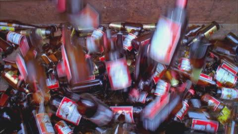 vídeos y material grabado en eventos de stock de ms ha glass bottles falling and breaking, santa barbara, california, usa  - botella